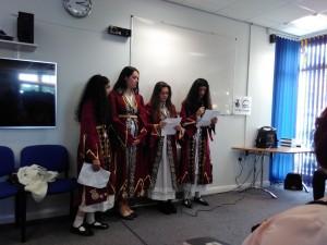Girls in traditional Bosnian dress read poems