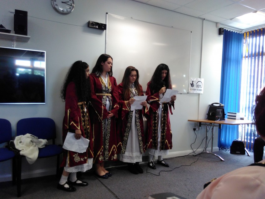 Girls in traditional Bosnian dress read poems