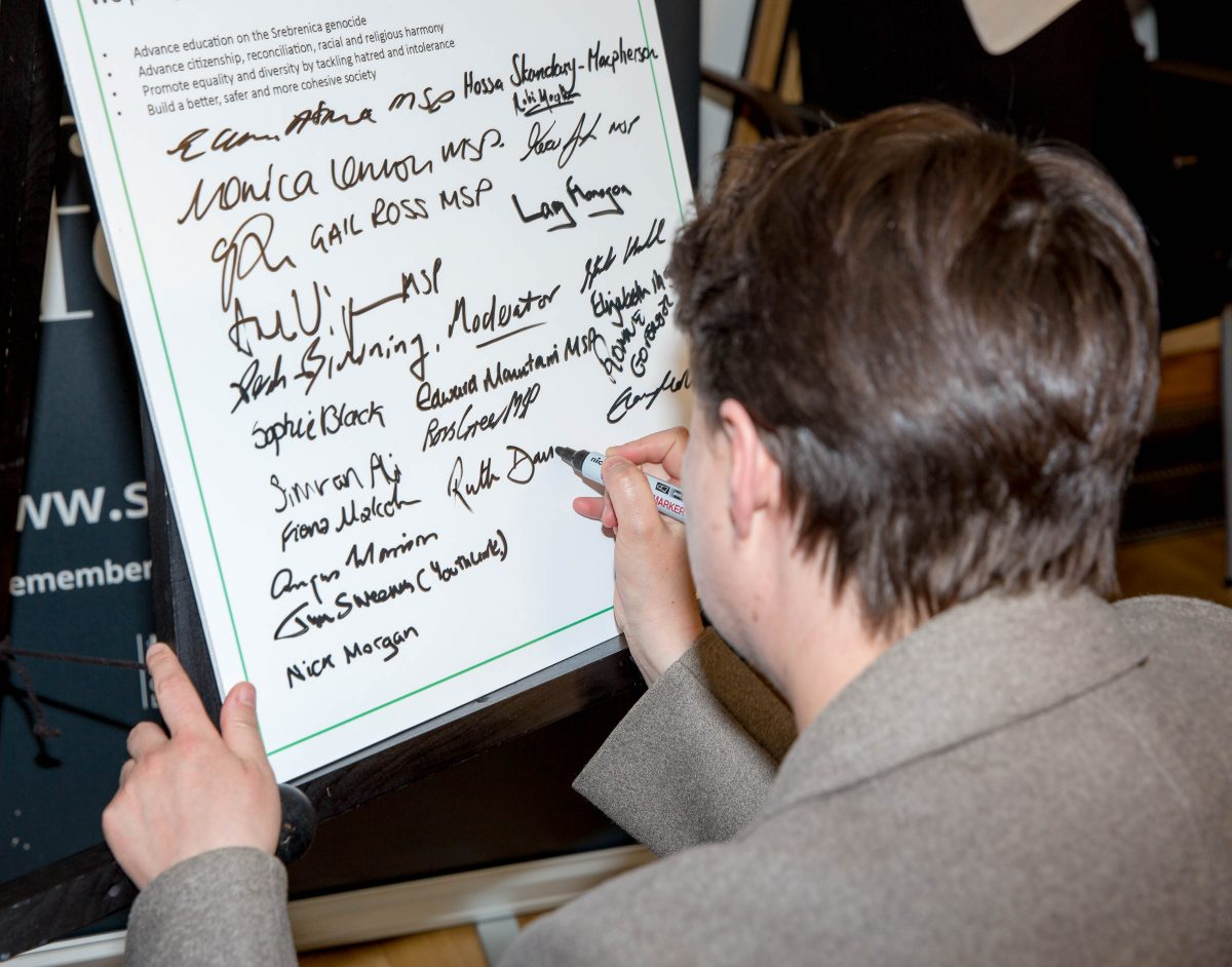 Ruth Davidson signing the pledge