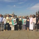 Genocide survivors lay flowers on London Bridge